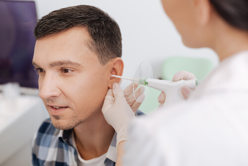man being treated for ear infection - service image ear nose throat