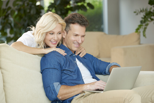 Couple Using Computer - Sleep Apnea Service Image