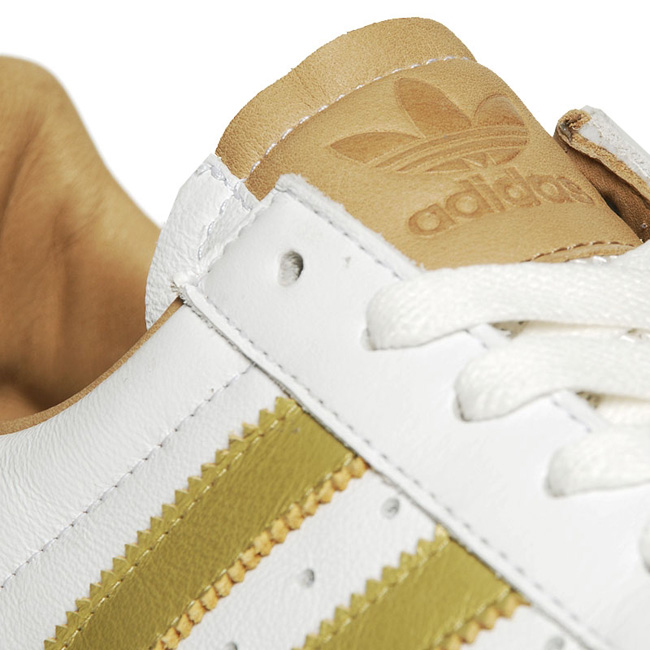 new product 168d1 bd1cd adidas Originals Grand Slam  White  Metallic Gold