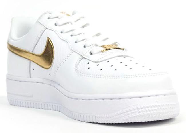nike wmns air force 1 low metallic gold