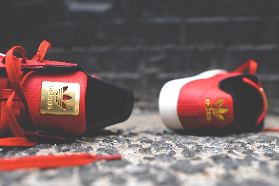 adidas superstar red black gold