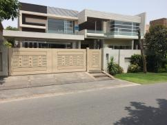 NEAR DHA 1 kanal brand new DESIGNERS house near park main road Rs126000