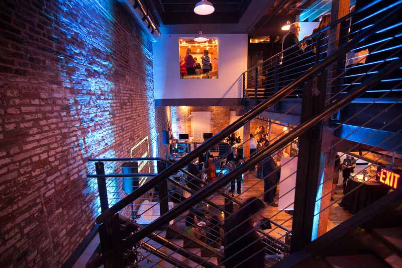 Nji media speakeasy blue event lighting on brick 2