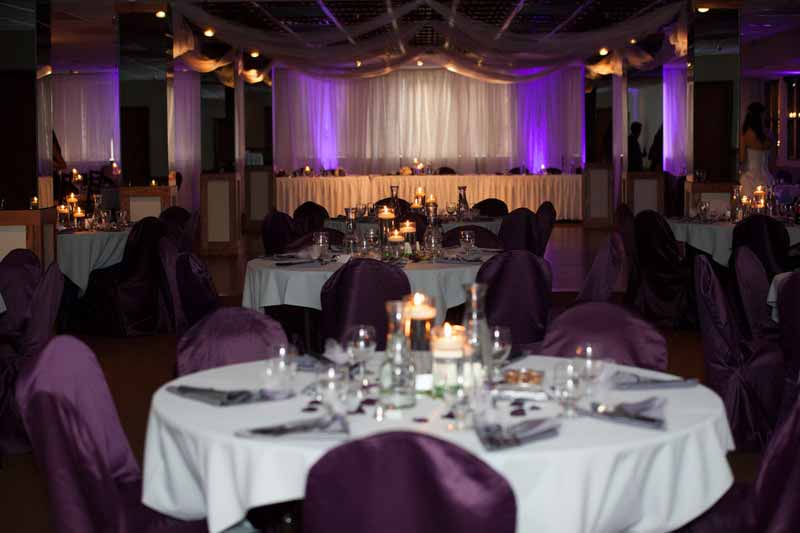 Purple wedding reception lighting