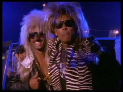 "Digital Underground                              's ""                               Same Song                              "" music video (feat.                               2Pac                              ); he makes an appearance at 2:20"