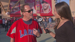An Angels fan tells Brie Thiele a story about the Larks jersey he's wearing