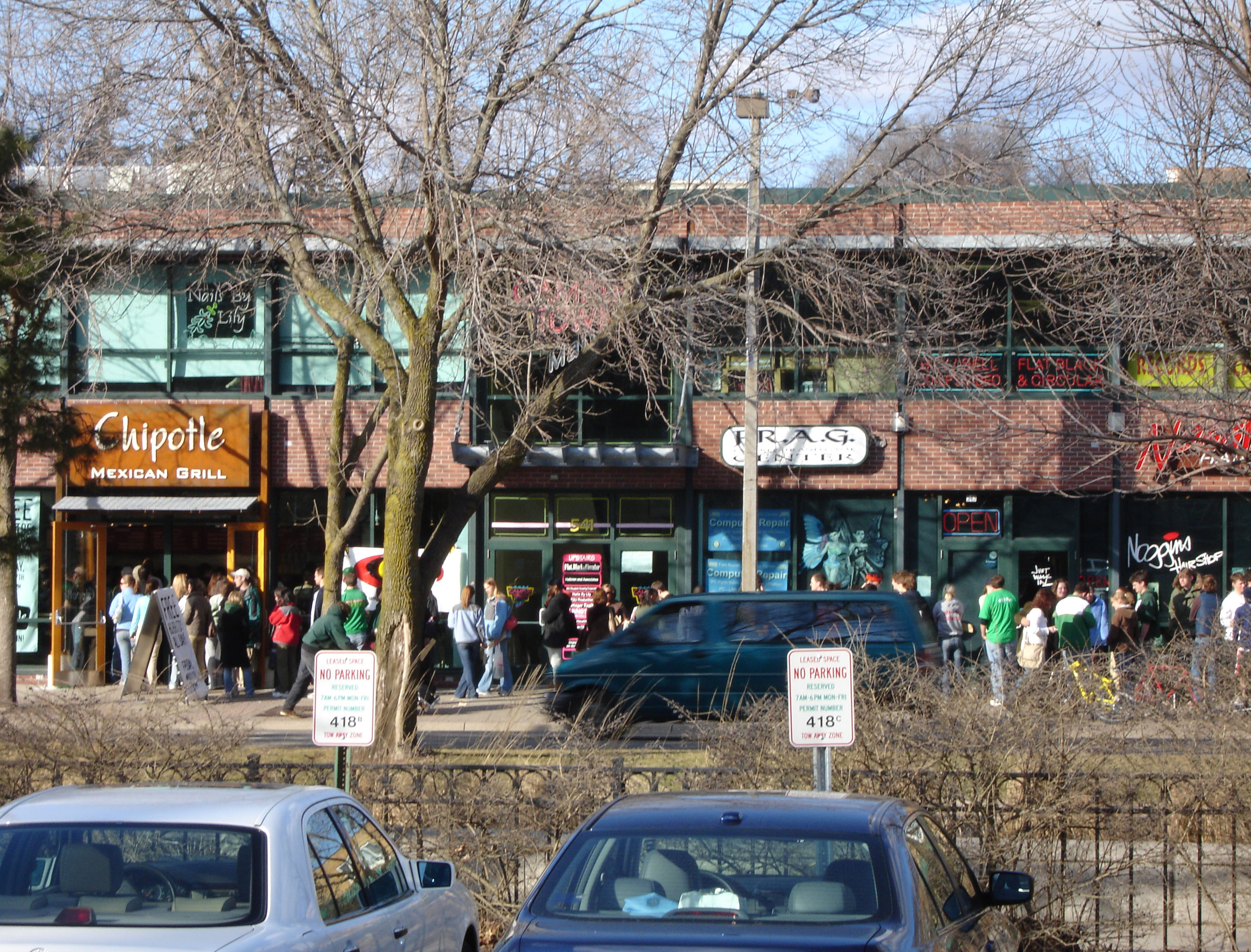 """People line up outside a Chipotle in East Lansing, Michigan during a """"Free Burrito Day"""""""