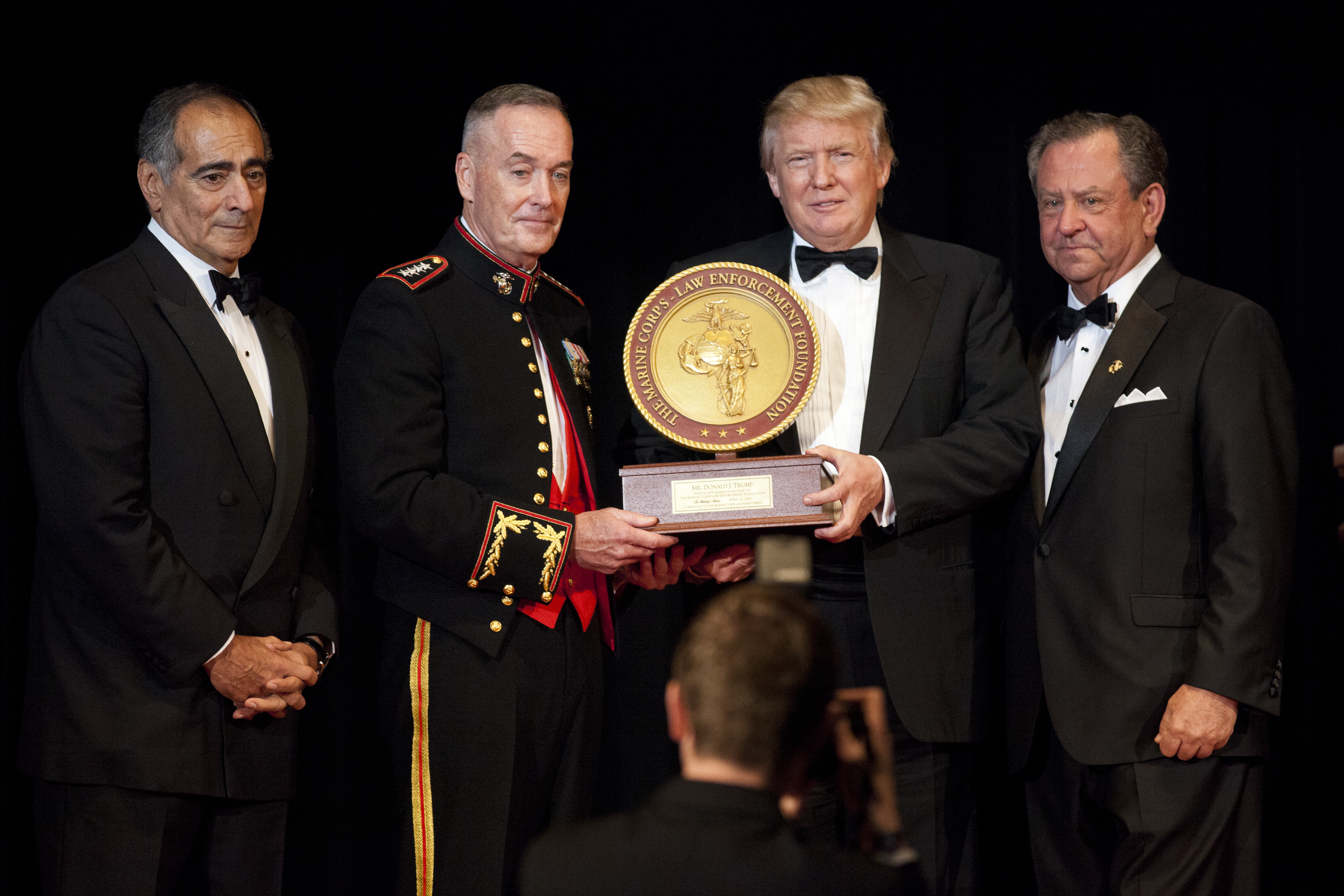 Trump receiving the 2015 Marine Corps–Law Enforcement Foundation's annual Leadership Award in recognition for his contributions to American military education programs.