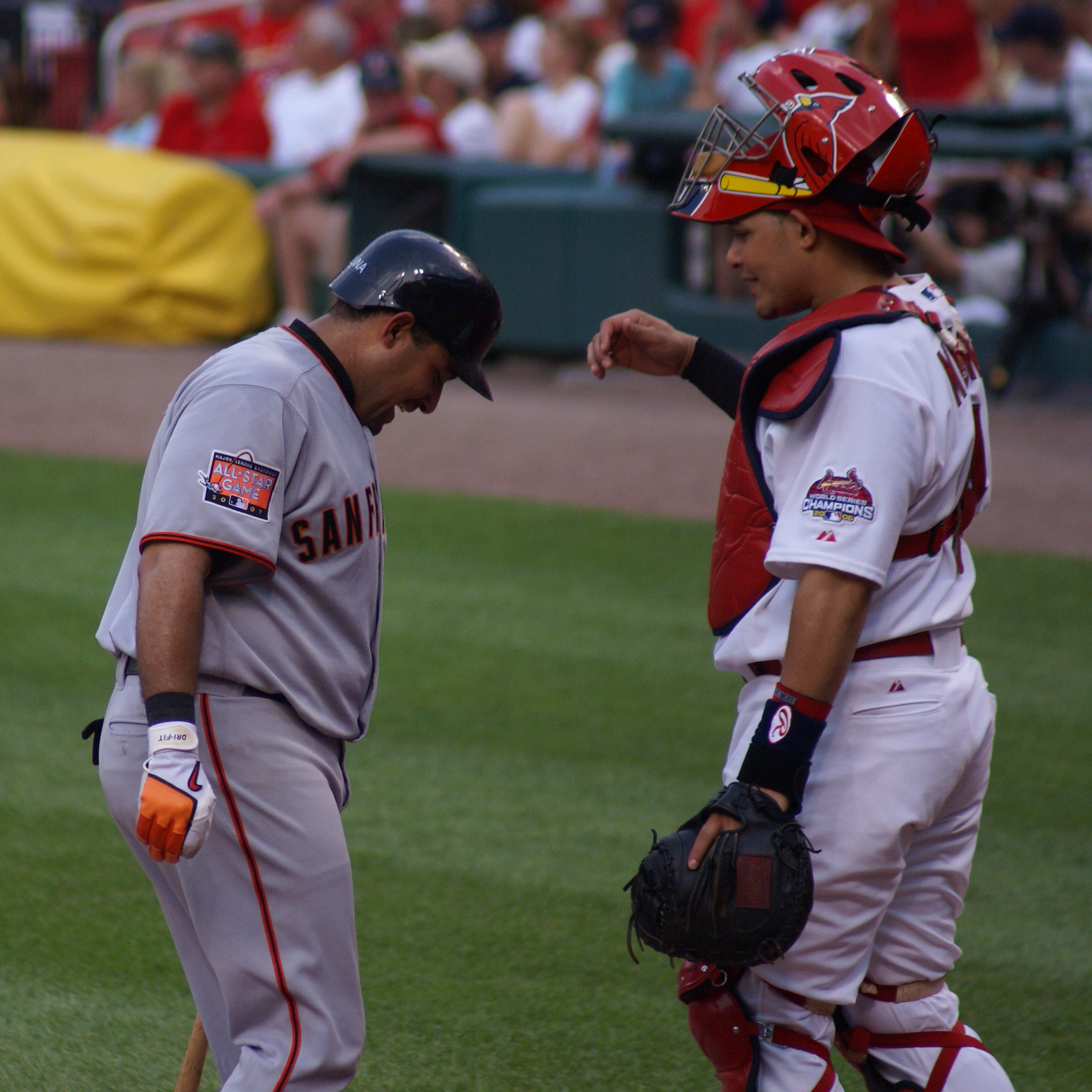 Molina interacting with his brother Bengie in a 2007 game, the first time they faced each other in the Major Leagues