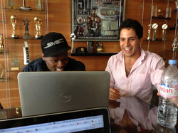 Mahbod Moghadam showing 50 Cent how to annotate his lyrics on Genius