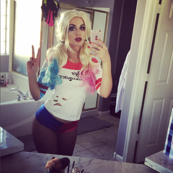 Another photo of SSSniperWolf cosplaying as DC Comics' Harley Quinn.