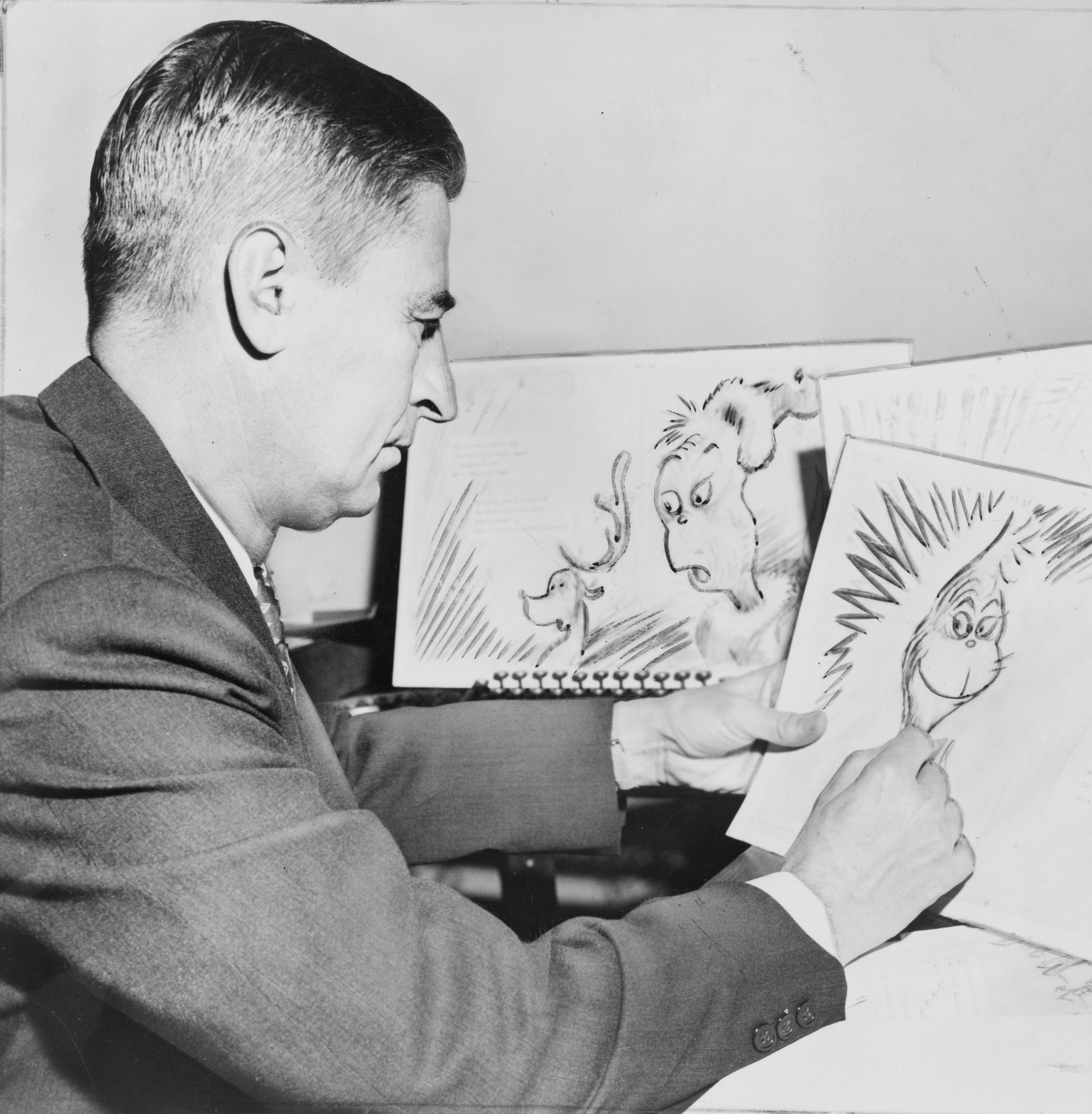 At work on a drawing of The Grinch for How the Grinch Stole Christmas!, in 1957