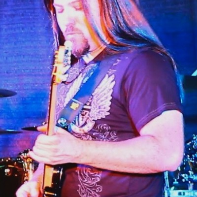 Chris Brouelette as John Petrucci