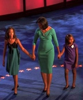 From left to right: Malia, Michelle, and Sasha on stage at the 2008 Democratic National Convention