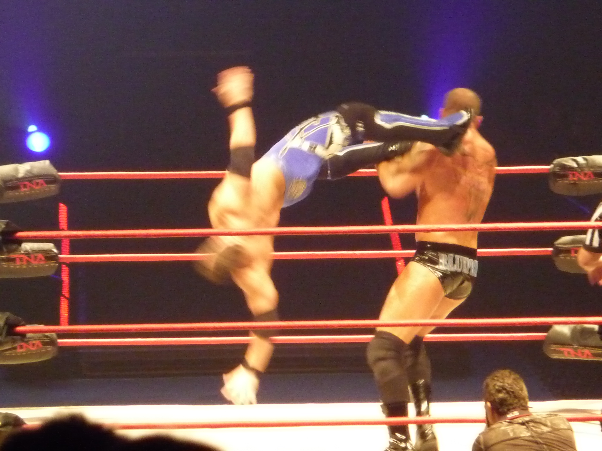 Styles performing a dropkick on Matt Morgan.