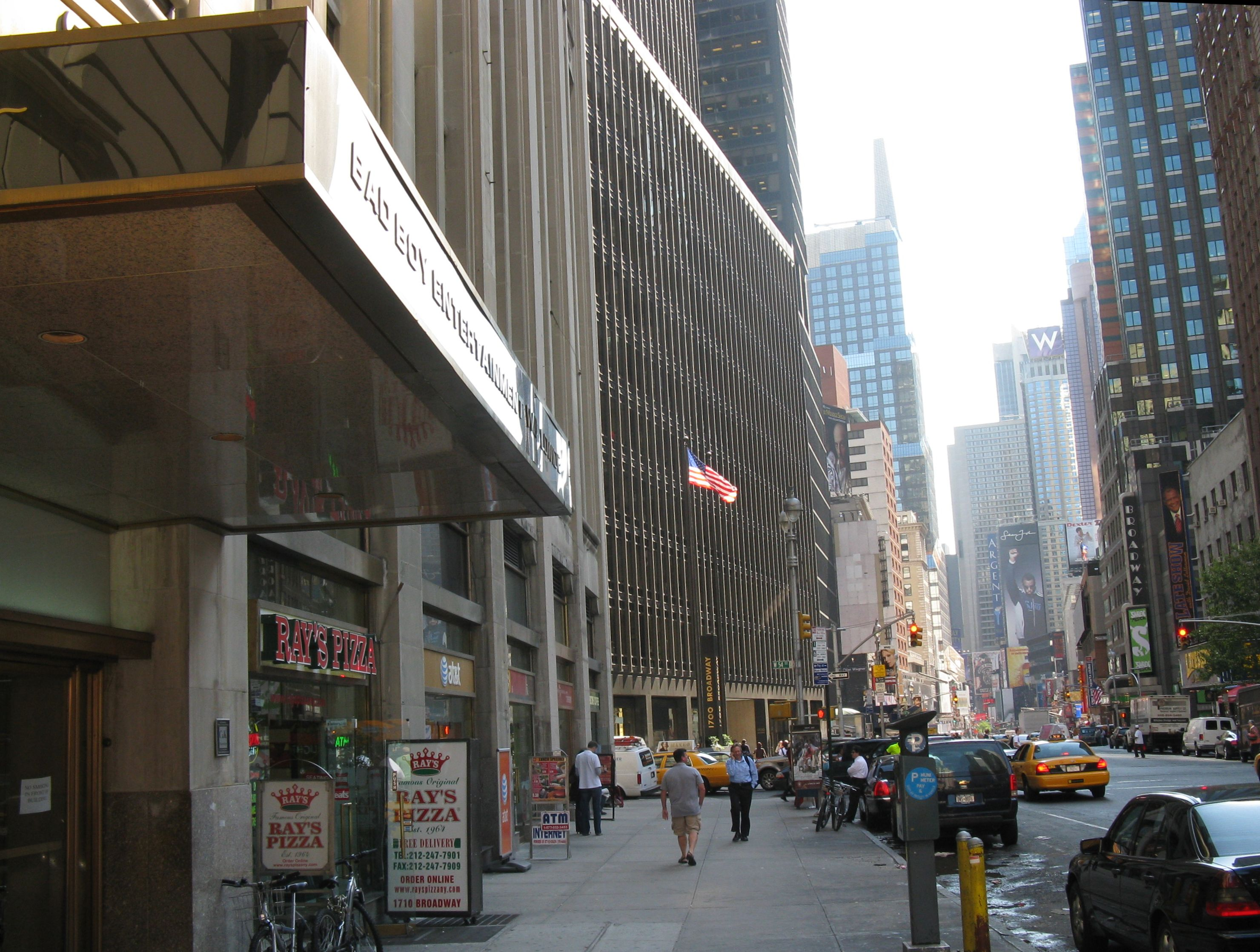 Bad Boy Entertainment Worldwide headquarters on Broadway near Times Square. A billboard of Combs is in the distance.