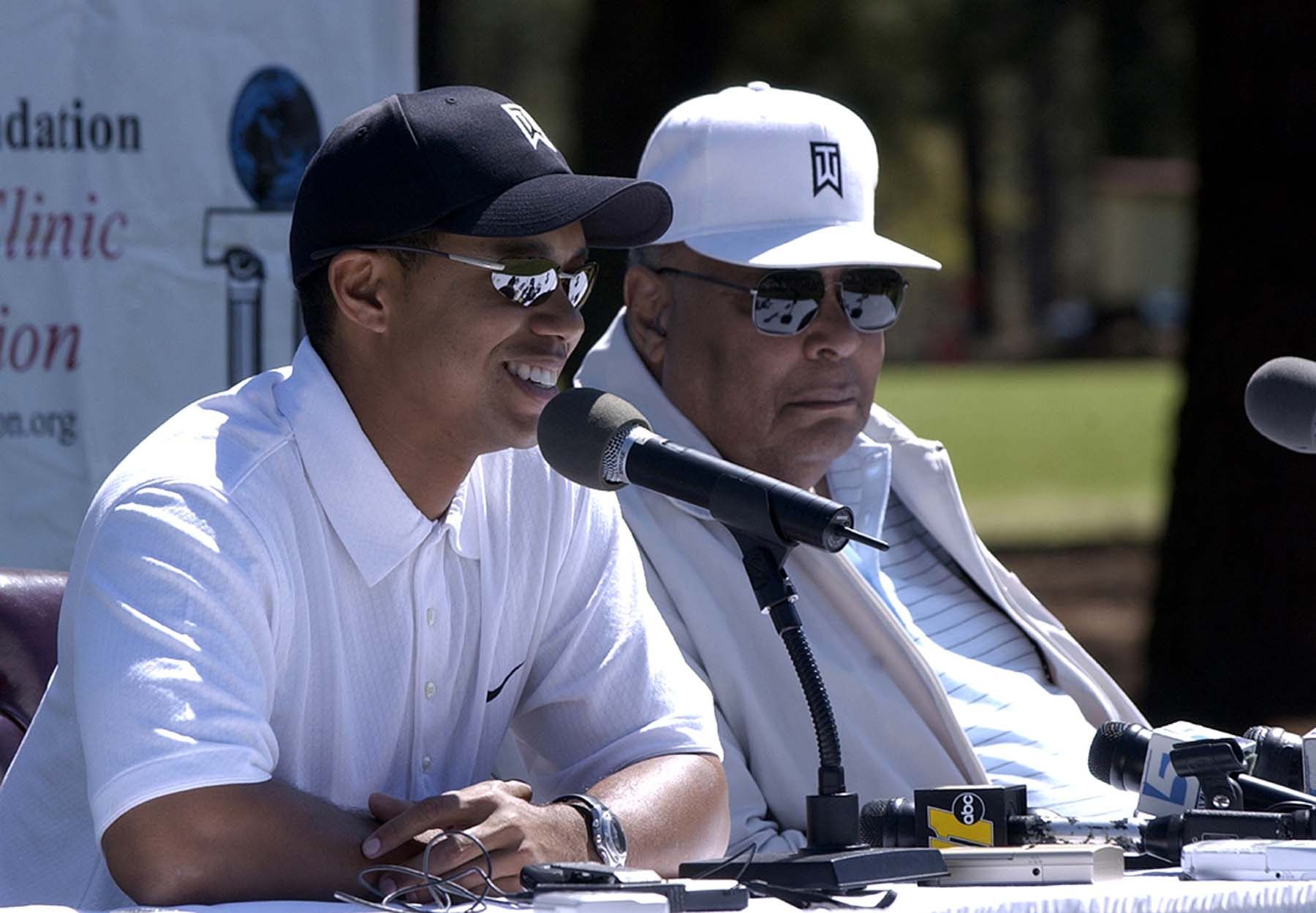 Woods with his father Earl in 2004