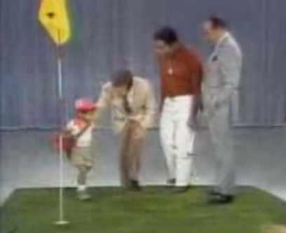Woods at age 2 on The Mike Douglas Show. From left, Tiger Woods, Mike Douglas, Earl Woods and Bob Hope on October 6, 1978.