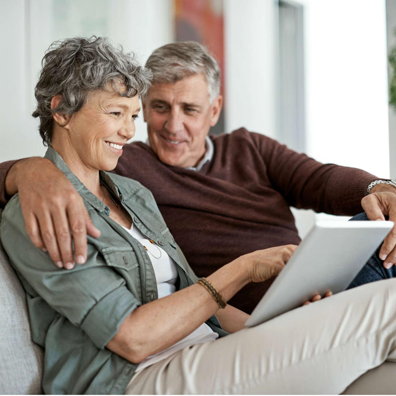 Older couple looking at iPad