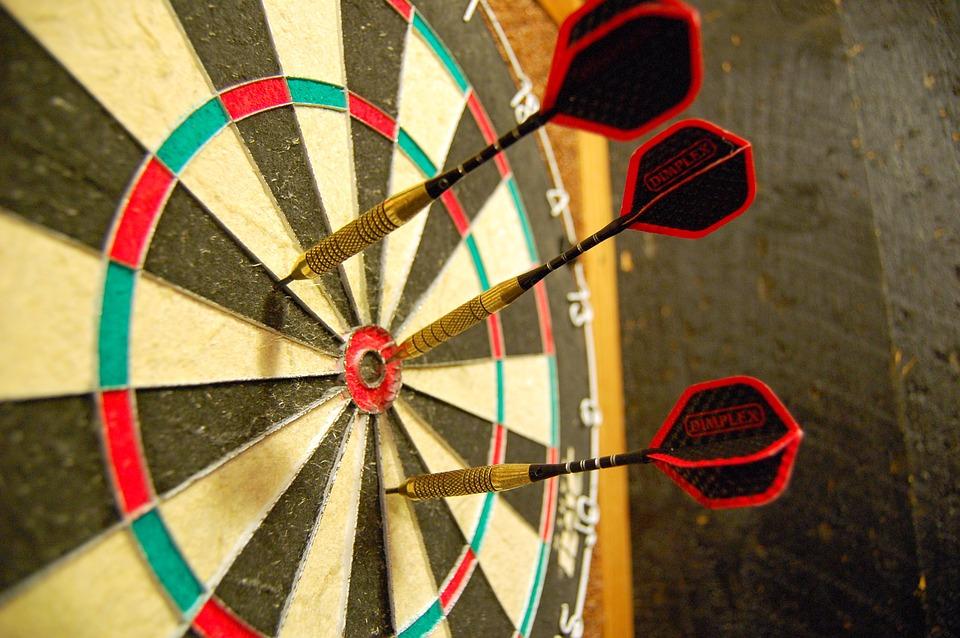 throwing darts at the board
