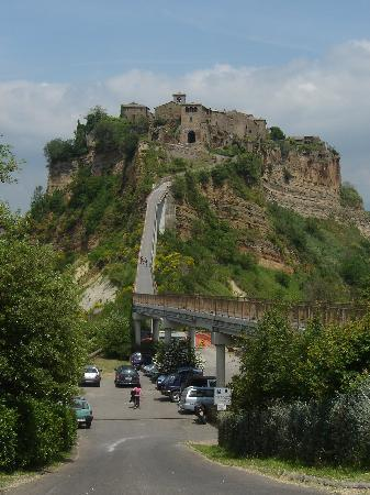 civita di bagnoregio is a town in the province of viterbo in central italy a frazione of the comune of bagnoregio 1 kilometre east from it