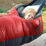 children camping in parachute nylon hammocks