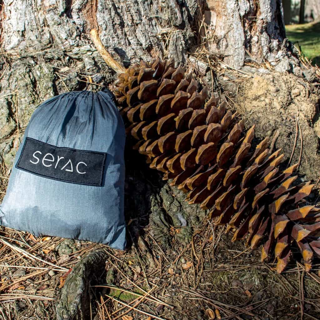 serac portable ultralight camping hammock drawstring compact stuff sack. the hammcok is smaller than a really big pine cone