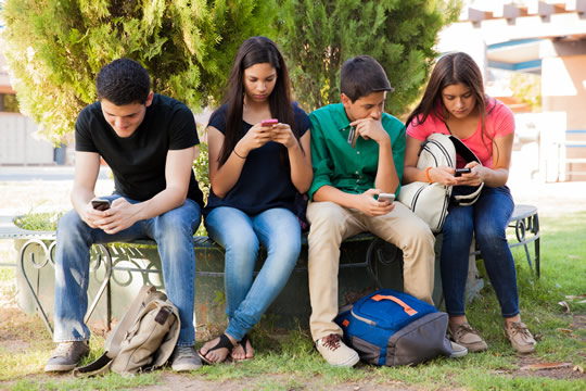 Teenagers with cell phones
