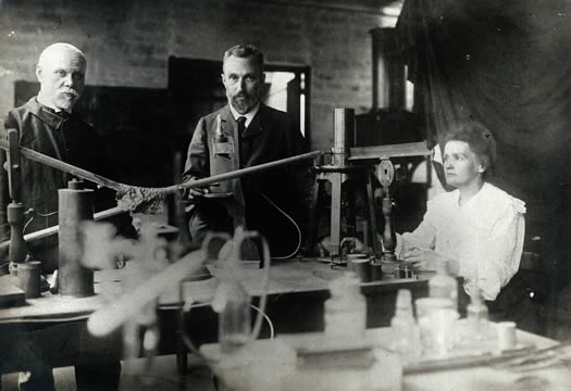 Marie and Pierre Curie (center) in their laboratory