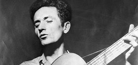 Woody guthrie playing guitar 631.jpg  800x600 q85 crop article