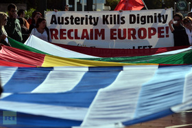 Hold banner anti austerity protest article
