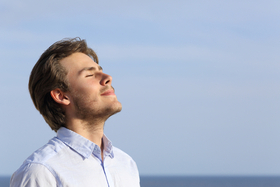 Man breathing deeply article
