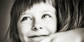 Girl hugging parent 300x150 article