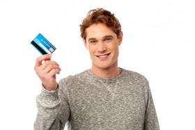 Bigstock cool guy showing his credit ca 54027610 e1430756376670 article
