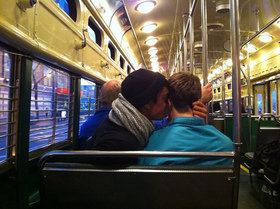 Men canoodle on train article