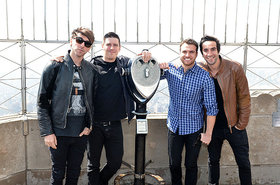 All time low empire state building billboard 650 article