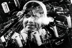 Man with a movie camera 1929 003 head superimposed on sewing machine article
