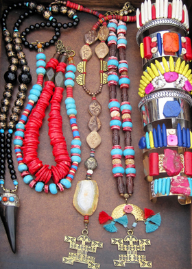 Tribal jewelry from cameri with pendants from colombia and horn pendant from tibet article