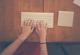 Hands woman apple desk large article