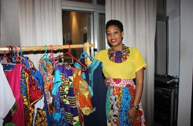1444254384uwase selling her beautiful and bright outfits at hotel des mille collines by kempinski after the rcfs article