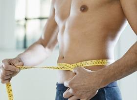 Man measuring waist article