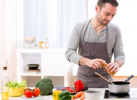 Man cooking in kitchen article