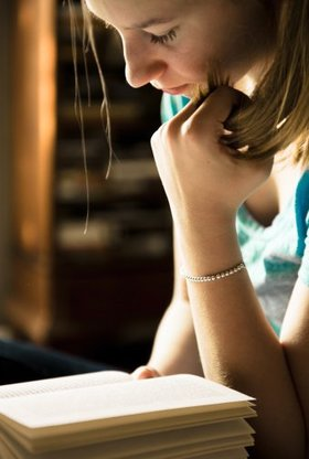 Girl reading article