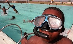 Child wearing snorkel and 012 article