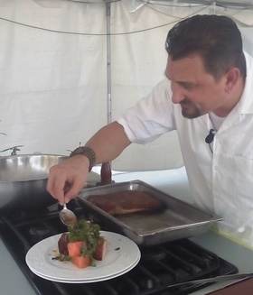 2015 11 22 chef costentino puts finishing touches on his slow roasted pork belly with watermelon  red onion and scotch bonnet pickle finished with toasted pistachios article