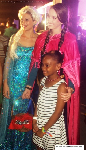 Elsa and anna from disney animated film frozen at christmas in the villages article