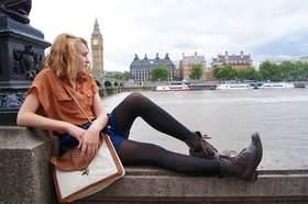 Woman sitting riverside thames big ben london article