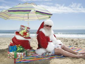 Santa on beach with presents credit www.dreamstime.com article