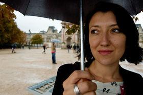 Woman paris umbrella closeup article