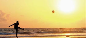 Sunset kickball toward sun article